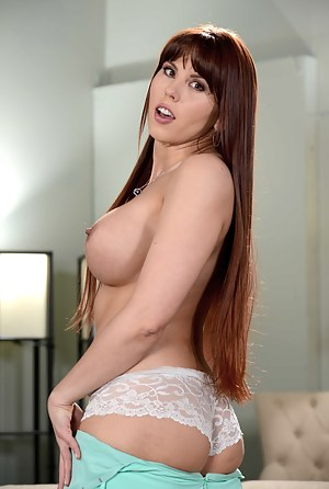She looks like your average girl-next-door hottie, but she also has them big fake tits, so it's possible she's a freak in the sheets too.
