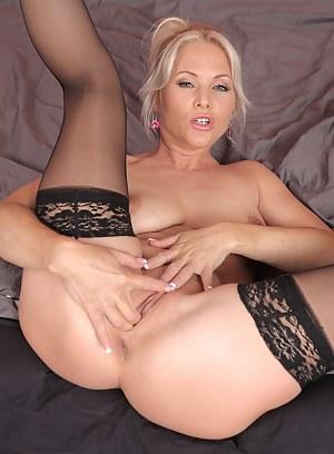 Beautiful 36 year old Marlene stuffs her long fingers deep inside her